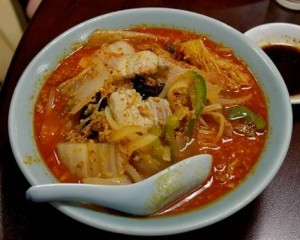 A bowl of kimchi and ramen