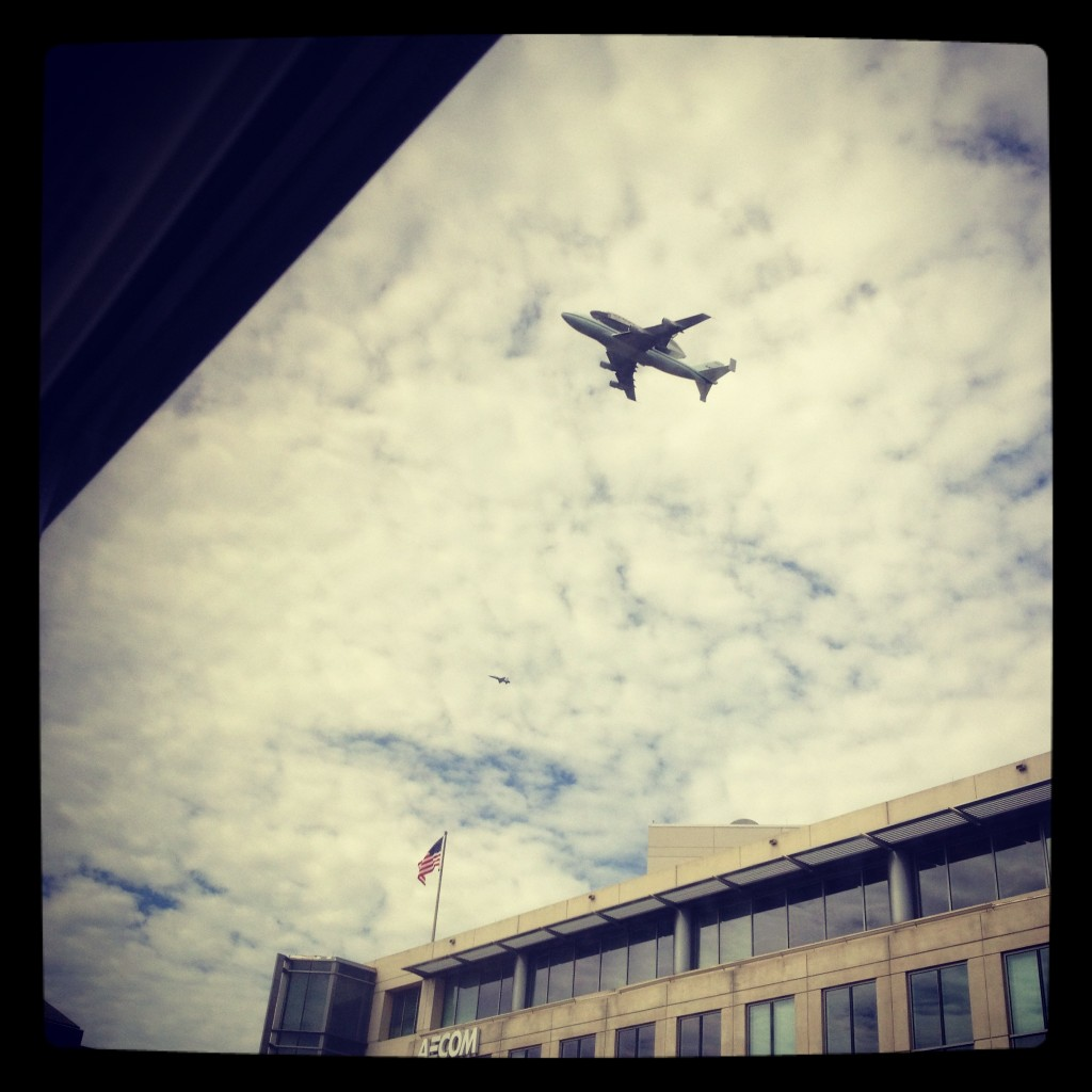 The space shuttle Discovery flies over my office in Arlington, Va.